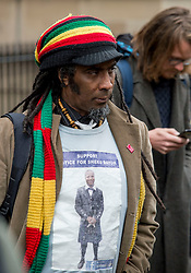 A supporter of the family of Sheku Bayoh outside the Crown Office.<br /> <br /> &copy; Dave Johnston / EEm