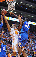 Mar 16, 2013; Knoxville, TN, USA; Tennessee Volunteers forward Jarnell Stokes (5) goes to the basket against Kentucky Wildcats forward Alex Poythress (22) during the second half at Thompson-Boling Arena. Tennessee won 88 to 58. Mandatory Credit: Randy Sartin-USA TODAY Sports