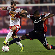Jonny Steele, New York Red Bulls, (left), is challenged by Andrew Farrell, New England Revolution, during the New York Red Bulls V New England Revolution, Major League Soccer regular season match at Red Bull Arena, Harrison, New Jersey. USA. 5th October 2013. Photo Tim Clayton