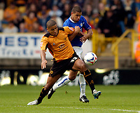 Photo: Richard Lane.<br /> Wolves v Leicester City. Coca Cola Championship.<br /> 17/09/2005.<br /> Wolves' Leon Clarke is challenged by Leicester's Patrick Kisnorbo.
