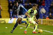 Huddersfield Town striker Jamie Paterson turns Birmingham City midfielder David Davis during the Sky Bet Championship match between Birmingham City and Huddersfield Town at St Andrews, Birmingham, England on 5 December 2015. Photo by Alan Franklin.