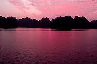 Stunning pink sunset colours the skies and calm waters of Halong Bay on christmas day 2009.