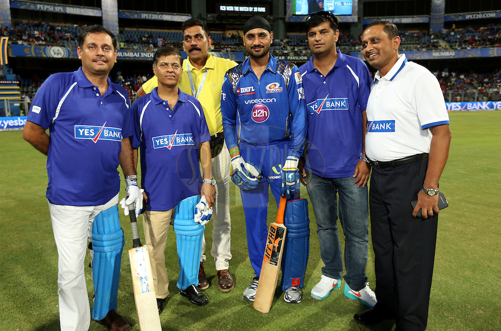 Mumbai Indians player Harbhajan Singh with Yes Bank team after the  match 46 of the Pepsi IPL 2015 (Indian Premier League) between The Mumbai Indians and The Royal Challengers Bangalore held at the Wankhede Stadium in Mumbai, India on the 10th May 2015.<br /> <br /> Photo by:  Sandeep Shetty / SPORTZPICS / IPL