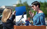 Heather Ramsey Cook, right, presents a Congressional certificate and flag to Jennifer Day, left, on behalf of Representative Ted Poe during a groundbreaking ceremony at Wharton PK-8 Dual Language Academy, May 5, 2017.