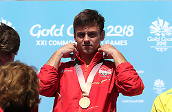 England's Tom Daley with his gold medal in the Men's Synchronised 10m Platform Final at the Optus Aquatic Centre during day nine of the 2018 Commonwealth Games in the Gold Coast, Australia. PRESS ASSOCIATION Photo. Picture date: Friday April 13, 2018. See PA story COMMONWEALTH Diving. Photo credit should read: Danny Lawson/PA Wire. RESTRICTIONS: Editorial use only. No commercial use. No video emulation.