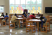 Students at Billy Reagan K-8 study in the library, which incorporates a large amount of natural light.