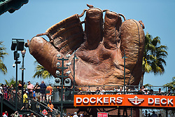 SAN FRANCISCO, CA - JUNE 25:  General view of a giant baseball glove in the outfield at AT&T Park during the seventh inning between the San Francisco Giants and the San Diego Padres on June 25, 2015 in San Francisco, California.  The San Francisco Giants defeated the San Diego Padres 13-8. (Photo by Jason O. Watson/Getty Images) *** Local Caption ***