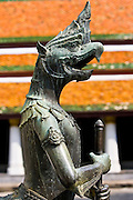 Mythical gryphon guards The Grand Palace and Temple complex, Bangkok, Thailand
