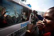Widespread street protests swept the Haitian capital of Port-au-Prince after preliminary results were announced the night before. While much of the violence was aimed at UN peacekeepers, most crowds were passive in the presence of Haitian National Police.