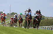 Jockey Luke Morris rides Jazri to victory during the 3.50 race at Brighton Racecourse, Brighton & Hove, United Kingdom on 10 June 2015. Photo by Bennett Dean.