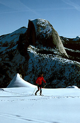 CA: Yosemite National Park, Cross Country skier, skiing, Half Dome in Background, snow in Yosemite                    .Photo Copyright: Lee Foster, lee@fostertravel.com, www.fostertravel.com, (510) 549-2202.cayose230