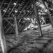 Panorama shot of an old barnloft falling down after years of use.