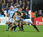 South Africa's Schalk Burger tackling Argentina's Tomas Cubelli during the Rugby World Cup Bronze Final match between South Africa and Argentina at the Queen Elizabeth II Olympic Park, London, United Kingdom on 30 October 2015. Photo by Matthew Redman.