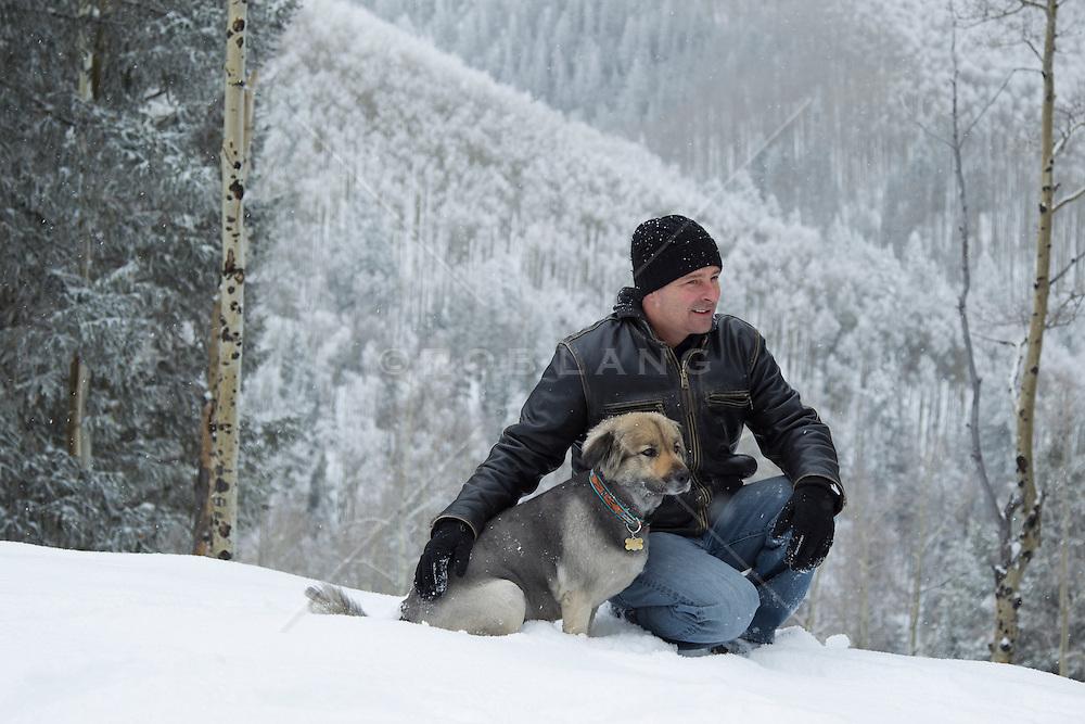 man enjoying his dog in the mountains of Santa Fe