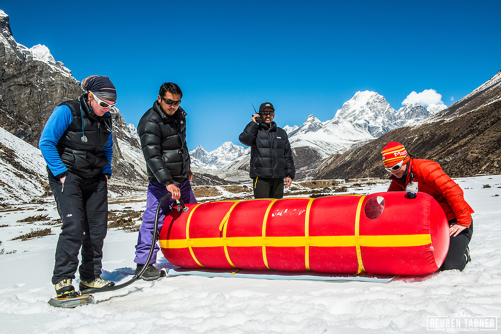 Doctors of the Himalayan Rescue Association use a Gamow Bag (a portable altitude chamber) to treat a victim of Altitude Illness at Pheriche (4,200m) in the Everest Region of Nepal.