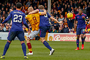 Curtis Main of Motherwell and Christophe Berra of Hearts tangle on the edge of the Hearts Box during the Ladbrokes Scottish Premiership match between Motherwell and Heart of Midlothian at Fir Park, Motherwell, Scotland on 17 February 2019.