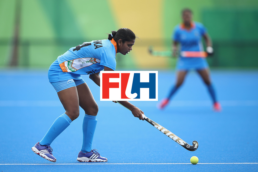 RIO DE JANEIRO, BRAZIL - AUGUST 07:  Monika of India looks to pass during the women's pool B match between Japan and India on Day 2 of the Rio 2016 Olympic Games at the Olympic Hockey Centre on August 7, 2016 in Rio de Janeiro, Brazil.  (Photo by Mark Kolbe/Getty Images)