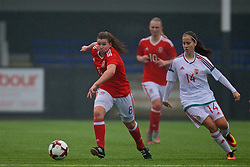 MERTHYR, WALES - Tuesday, February 14, 2017: Wales' Cassia Pike in action against Hungary's Eszter Kovács during a Women's Under-17's International Friendly match at Penydarren Park. (Pic by Laura Malkin/Propaganda)
