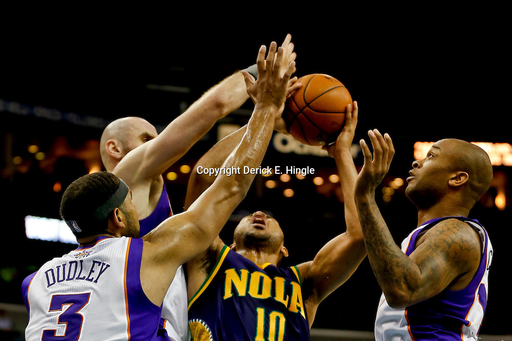 Feb 6, 2013; New Orleans, LA, USA; New Orleans Hornets shooting guard Eric Gordon (10) shoots as Phoenix Suns shooting guard Jared Dudley (3) and center Marcin Gortat (4) and shooting guard P.J. Tucker (17) defend during the second quarter of a game at the New Orleans Arena. Mandatory Credit: Derick E. Hingle-USA TODAY Sports