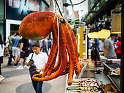 10 JUNE 2018 - SEOUL, SOUTH KOREA: A grilled octopus stand on Myeong-dong.    PHOTO BY JACK KURTZ