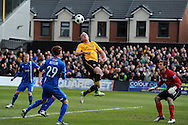 Newport county's Lee Minshull © tries to get on the end of a header at goal. Blue square bet premier div, play off semi final match, 2nd leg, Newport county v Grimsby Town at Rodney Parade in Newport, South Wales on Sunday 28th April 2013. pic by Andrew Orchard,  Andrew Orchard sports photography,