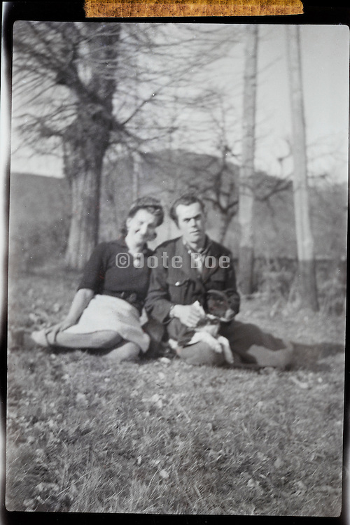 husband and wife in countryside 1950s out of focus