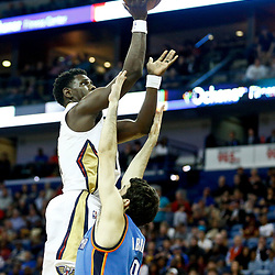 Jan 25, 2017; New Orleans, LA, USA; New Orleans Pelicans guard Jrue Holiday (11) shoots over Oklahoma City Thunder guard Alex Abrines (8) during the second half of a game at the Smoothie King Center. The Thunder defeated the Pelicans 114-105. Mandatory Credit: Derick E. Hingle-USA TODAY Sports