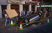 The clean-up begins the morning after the Poll Tax riot,  on 1st April 1990, in Charing Cross Road, London, England. Angry crowds, demonstrating against Margaret Thatcher's local authority tax, stormed the Whitehall area and then London's West End, setting fire to a construction site and cars, looting stores up Charing Cross Road and St Martin's Lane. The anti-poll tax rally in central London erupted into the worst riots seen in the city for a century. Forty-five police officers were among the 113 people injured as well as 20 police horses. 340 people were arrested.