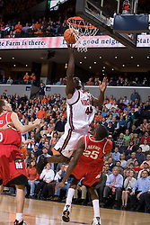 Virginia's Soloman Tat (45) shoots over Maryland's Ekene Ibekwe (25).  The Cavaliers defeated the #22 ranked Terrapins 103-91 at the John Paul Jones Arena in Charlottesville, VA on January 16, 2007.
