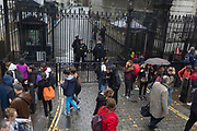 Armed police stand guard at the gates of Downing Street, the official residence and offices of British Prime Minister Theresa May, on 19th October 2017, in London, England.