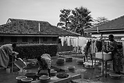 Women who are staying with their children wash clothes inside the Cure hospital compound on February 2, 2017.