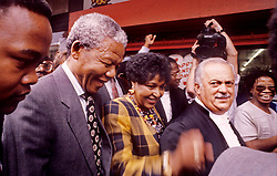 1991 - Johannesburg, South Africa - NELSON MANDELA, WINNIE MANDELA and GEORGE BIZOS are mobbed by well wishers on their way to Winnie's kidnapping case. Exact date unknown..(Credit Image: © Greg Marinovich/ZUMA Wire/ZUMAPRESS.com)