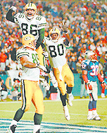 (Published caption 10/28/97) Packers' Mark Chmura (89), Antonio Freeman (86) and Derrick Mayes (80) celebrate after Chmura's 32-yard touchdown reception just before halftime Monday.