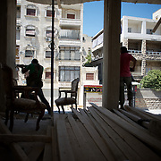 August 10, 2012 - Aleppo, Syria: A group of Free Syria Army (FSA) fighters aim at a Syrian Army snipper during an advance towards the frontline in Saheledine, a strategic neighborhood in southwest Aleppo...The Syrian Army have in the past week increased their attacks on residential neighborhoods where Free Syria Army rebel fights have their positions in Syria's commercial capital, Aleppo. (Paulo Nunes dos Santos/Polaris)