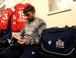 Jordan Williams of Bristol Rugby reads the match day programme in the Nottingham Rugby dressing room - Mandatory by-line: Robbie Stephenson/JMP - 06/04/2018 - RUGBY - The Bay - Nottingham, England - Nottingham Rugby v Bristol Rugby - Greene King IPA Championship
