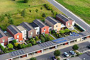 Nederland, Flevoland, Gemeente Almere, 27-08-2013; nieuwbouwwijk Noorderplassen. Zonnecollectoren op de daken van de carport.<br /> Solar collectors on the roof of new constructed houses of a new residential district in Almere.<br /> luchtfoto (toeslag op standaard tarieven);<br /> aerial photo (additional fee required);<br /> copyright foto/photo Siebe Swart.