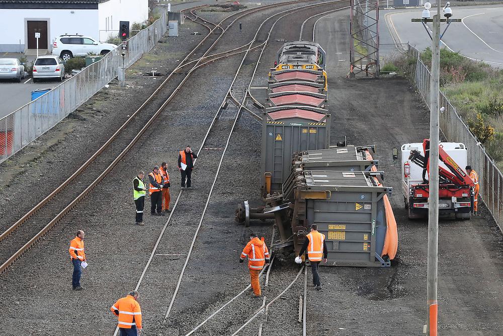 A freight wagon lies on its side after a goods train derailment in Dunedin, New Zealand, Tuesday, September 27, 2016. Credit:SNPA / Adam Binns ** NO ARCHIVING**