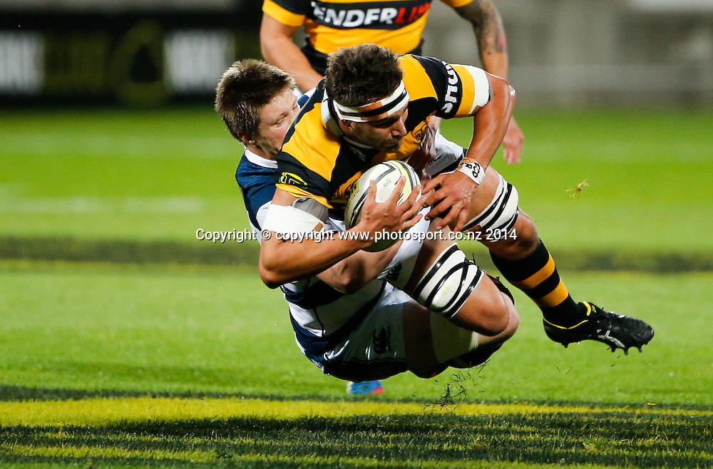 Taranaki's Riki Hoeata is tackled. ITM Cup Rugby, Taranaki v Auckland, Yarrow Stadium, New Plymouth, New Zealand. Friday, 26 September, 2014. Photo: John Cowpland / www.photosport.co.nz