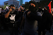 Members of the anarchist group Intifa gather at Dallas City hall to protest agsainst Donald Trump and white supremacist groups on Saturday August 19, 2017.
