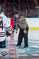 KELOWNA, CANADA - SEPTEMBER 5: Referee Kevin Crowell stands at centre ice between the Kelowna Rockets and the against the Kamloops Blazers on September 5, 2017 at Prospera Place in Kelowna, British Columbia, Canada.  (Photo by Marissa Baecker/Shoot the Breeze)  *** Local Caption ***