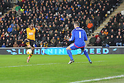 Hull City midfielder Sone Aluko (24) scores to go 1 all during the Sky Bet Championship match between Hull City and Nottingham Forest at the KC Stadium, Kingston upon Hull, England on 15 March 2016. Photo by Ian Lyall.