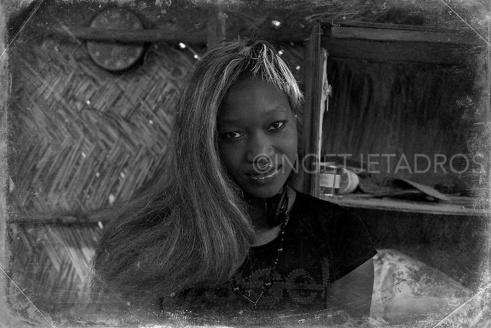 One on three woman wear a wig in West Africa. Burkino Faso