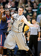 SHOT 2/14/13 8:44:29 PM - Colorado's Shane Harris-Tunks #15 battles for position down low against Arizona's Angelo Chol #30 during their regular season Pac-12 basketball game at the Coors Event Center on the Colorado campus in Boulder, Co. Colorado won the game 71-58. (Photo by Marc Piscotty / © 2013)