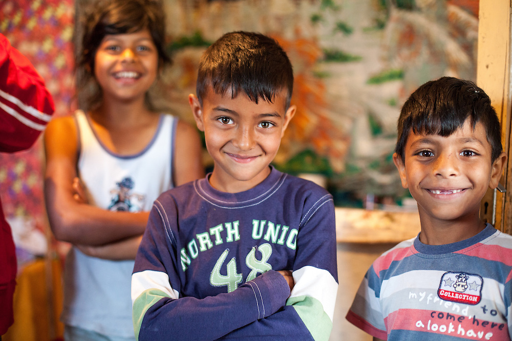 Children of the Nae family posing for a photograph in their house located in the Roma area of Frumusani.