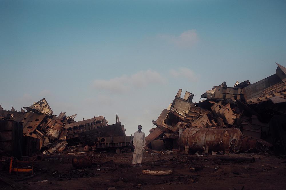 A man overlooks demolition work at the Gadani ship breaking yard, Balochistan Province, Pakistan on August 16, 2011.