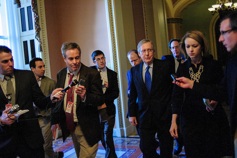 Senate Minority Leader Mitch McConnell (R-KY) is questioned by reporters as he walks to his office from the Senate Floor. Fiscal cliff negotiations continue at the U.S. Capitol in Washington, District of Columbia, U.S., on Sunday, Dec. 30, 2012. A combination of spending cuts and tax increases are set to kick in within hours unless congressional Republicans and Democrats cut a last-minute deal. Photographer: Pete Marovich/Bloomberg