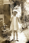 A little girl standing outdoors