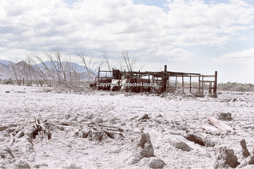 Abandoned, salt-encrusted structures on the Salton Sea Beach shore