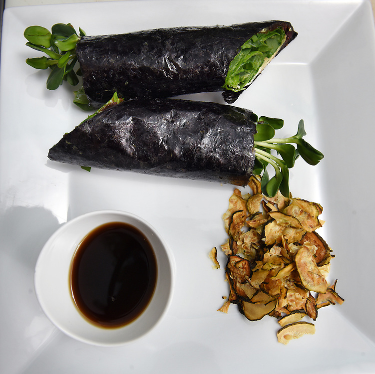 "Mara Lavitt /For Hearst Connecticut Media<br /> February 6, 2016<br /> Catch A Healthy Habit Cafe, Fairfield. The nori wrap: nori, fig marmalade, cashew ""cheese,"" beet, sunflower sprouts, avocado, crispy onion, spinach, ""salt & vinegar"" zucchini chips; and a dipping sauce."