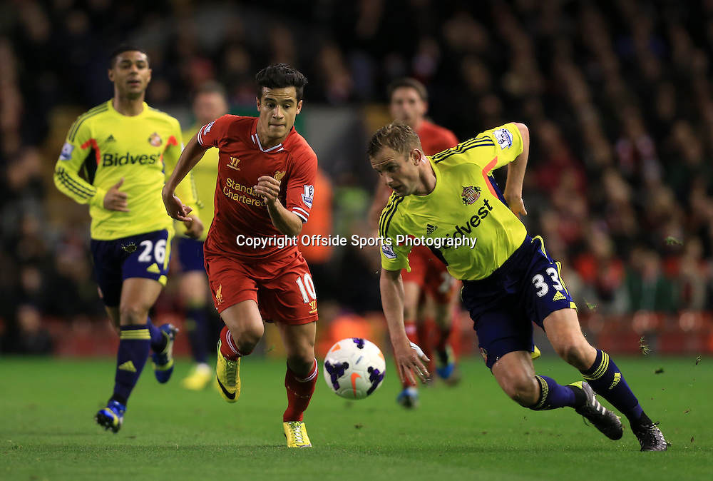 26th March 2014 - Barclays Premier League - Liverpool v Sunderland - Philippe Coutinho of Liverpool battles with Lee Cattermole of Sunderland - Photo: Simon Stacpoole / Offside.